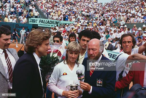 American tennis player Chris EvertLloyd is interviewed by NBC Sports commentator Bud Collins after she won the French Open at the Stade Roland Garros...