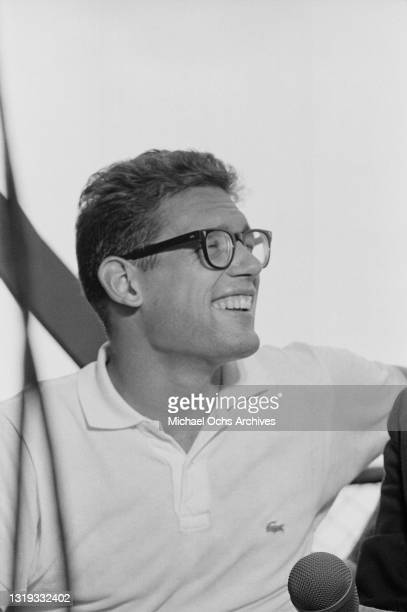 American tennis player Clark Graebner takes a rest break during the Men's Singles Semifinal of the 1968 US Open, held at West Side Tennis Club in the...