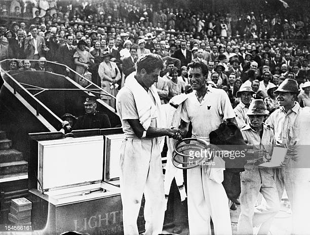 American tennis player Frank Shields congratulates Fred Perry of Great Britain on his victory in their Davis Cup Challenge Round match on the Centre...