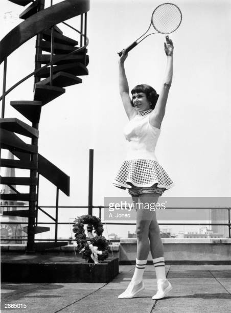 American tennis player Gussie Moran famous for her frilly pants models a tennis outfit on the roof of Simpsons a London department store