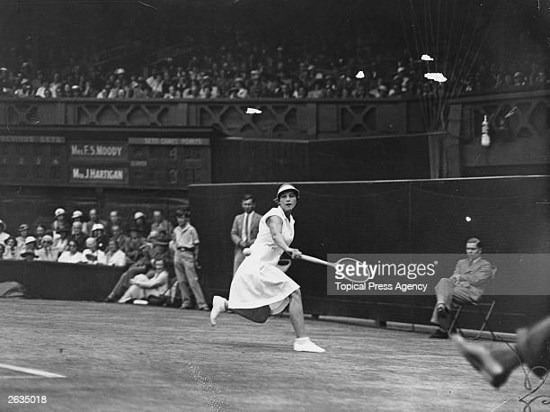 American tennis player Helen Wills Moody in action against Australia's Joan Hartigan during their semifinal match at Wimbledon Original Publication...
