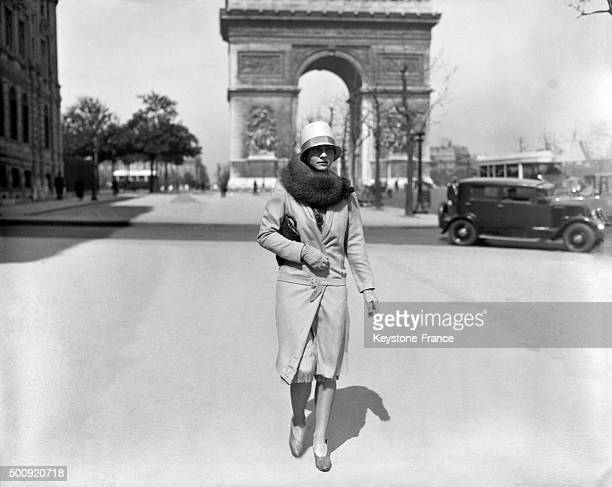 American tennis player Helen Wills strolling on the ChampsElysées avenue in 1927 in Paris France