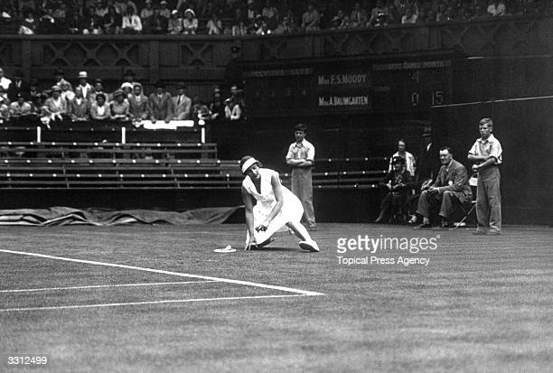 American tennis player Helen WillsMoody on the ground after falling during her match against Mlle Baumgarten of Hungary at Wimbledon