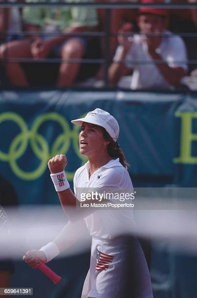 American tennis player Jennifer Capriati of the United States team pictured in action against Steffi Graf of Germany in the final to win the gold...