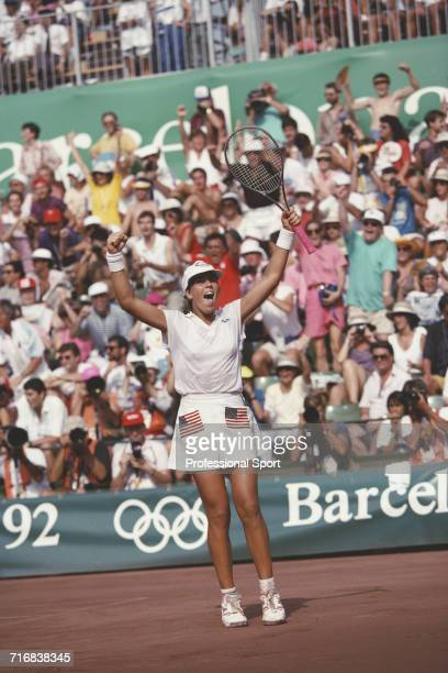 American tennis player Jennifer Capriati of the United States team pictured celebrating after beating Steffi Graf of Germany in the final to win the...
