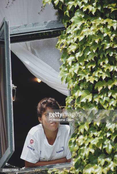 American tennis player Jennifer Capriati pictured looking out of a window at the All England Tennis Club during progress to reach the semifinals of...