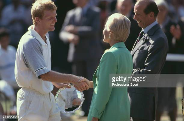 American tennis player Jim Courier holding the runner up's plate pictured shaking hands with Katharine Duchess of Kent as Prince Edward Duke of Kent...