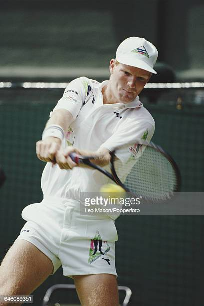 American tennis player Jim Courier pictured in action competing to reach the third round in the Men's Singles tournament at the Wimbledon Lawn Tennis...