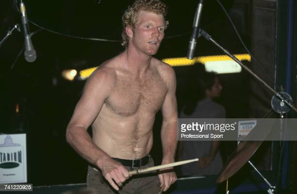 American tennis player Jim Courier pictured in action playing a set of drums in a break from competition during progress to reach the quarterfinals...