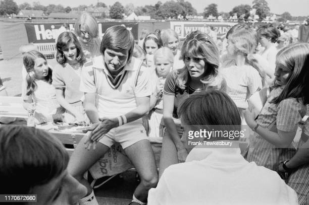 American tennis player Jimmy Connors and his fiancee American actress TV Host model and beauty queen Marjorie Wallace talk to children near a tennis...