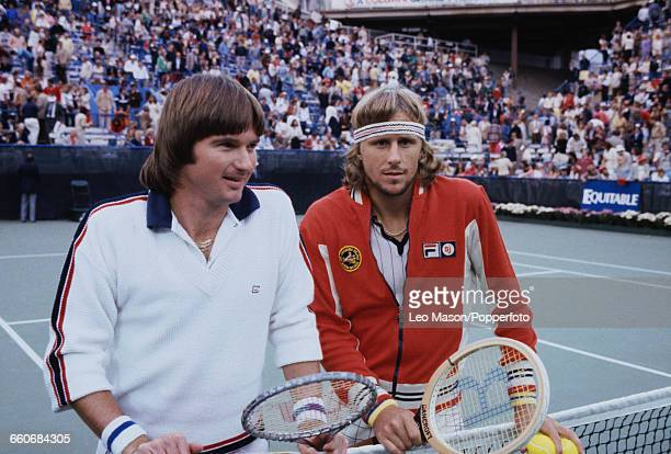 American tennis player Jimmy Connors and Swedish tennis player Bjorn Borg stand together beside the net in front of press photographers before the...