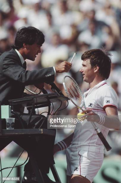 American tennis player Jimmy Connors appeals to the umpire during play to reach the semifinals of the Men's Singles tournament at the 1985 French...