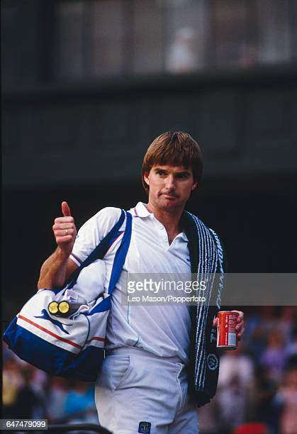 American tennis player Jimmy Connors pictured holding a can of coca cola while giving a thumbs up to the crowd as he competes to reach the semifinals...
