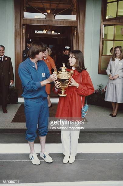 American tennis player Jimmy Connors pictured holding the Gentlemen's Singles Challenge CupTrophy with his wife Patti McGuire after winning the men's...
