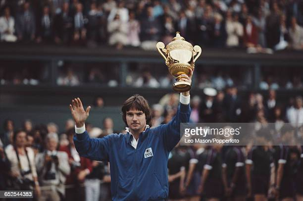 American tennis player Jimmy Connors pictured holding the Gentlemen's Singles trophy after beating John MceEnroe in the final of the Men's Singles...