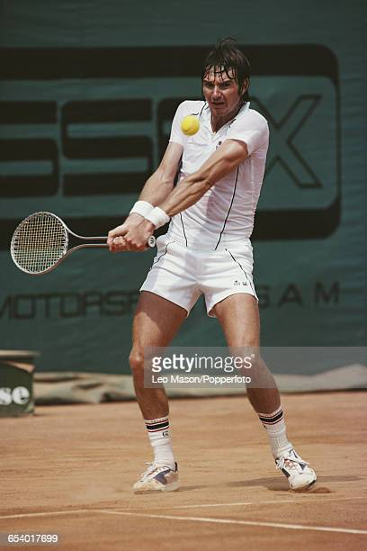 American tennis player Jimmy Connors pictured in action competing to reach the final of the Men's Singles tournament against Guillermo Vilas of...