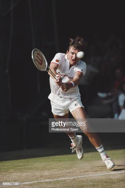 American tennis player Jimmy Connors pictured in action competing to progress to reach the final of the Men's Singles tournament at the Wimbledon...
