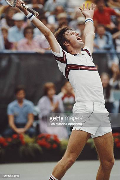 American tennis player Jimmy Connors pictured in action raising his hands in the air in celebration during competition to reach the semifinals of the...