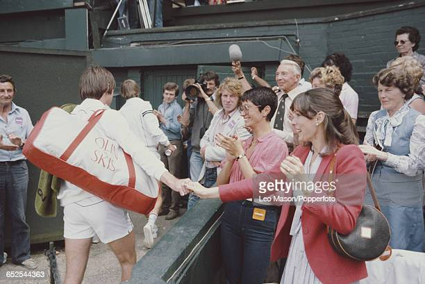 American tennis player Jimmy Connors pictured shaking hands with his wife Patti McGuire after beating Gene Mayer in the quarterfinals before...