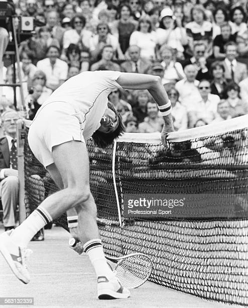 American tennis player Jimmy Connors runs into the net to make a shot during a match on Centre Court at Wimbledon Tennis Championships in London June...