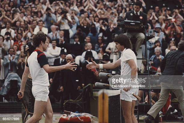 American tennis player Jimmy Connors shakes hands with fellow American tennis player John McEnroe after defeating him in the final of the Men's...