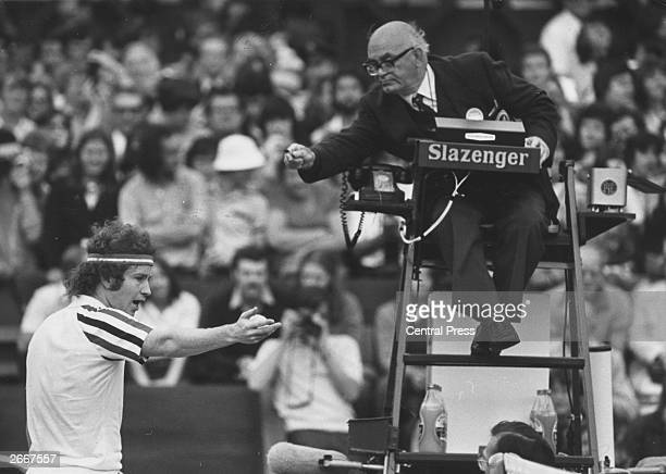 American tennis player John McEnroe argues a point with the umpire during his semifinal match against compatriot Jimmy Connors in the men's singles...