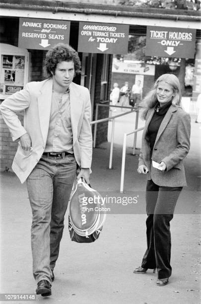American tennis player John McEnroe arrives with his girlfriend American tennis player Stacy Margolin ahead of her tennis match at Devonshire Park in...