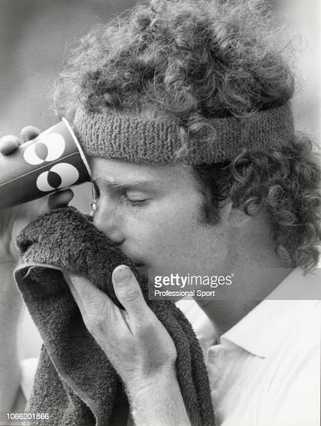 American tennis player John McEnroe bathes his eye during a break in play to win the final of the Men's Singles tournament against Bjorn Borg of...