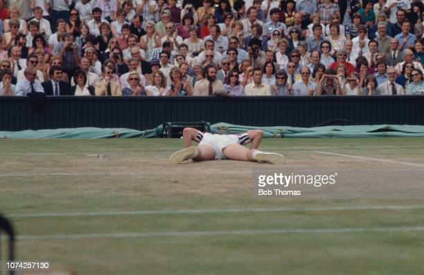 American tennis player John McEnroe flat out on Centre Court during the Men's Singles Final against Bjorn Borg of Sweden at the Wimbledon...