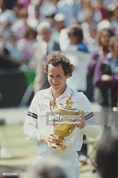 American tennis player John McEnroe holds the Gentlemen's Singles Trophy after defeating Chris Lewis of New Zealand 62 62 62 in the final of the...