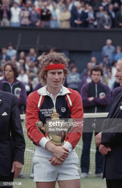 American tennis player John McEnroe holds up the Gentlemen's Singles Trophy after defeating Bjorn Borg of Sweden 46 76 76 64 in the final of the...