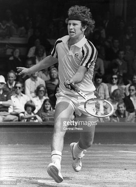 American tennis player John McEnroe in action during his quarter final match against Peter Fleming at Wimbledon McEnroe won