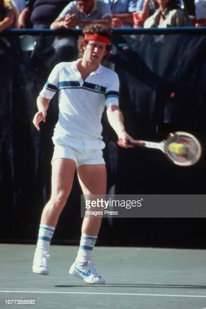 American tennis player John McEnroe in action on the centre court against Bjorn Borg at the Wimbledon Tennis Championships