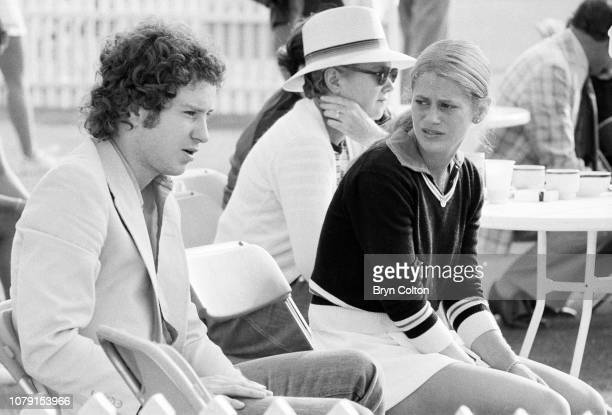 American tennis player John McEnroe left sits with his girlfriend American tennis player Stacy Margolin ahead of her tennis match at Devonshire Park...