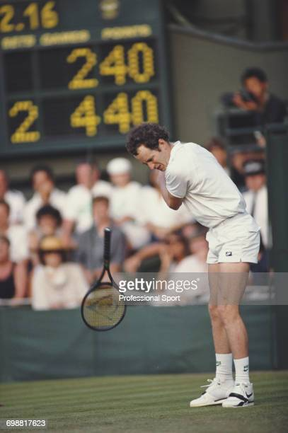 American tennis player John McEnroe pictured dropping his racket in action during competition to reach the second round of the Men's Singles...