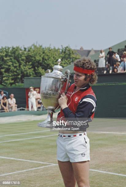 American tennis player John McEnroe pictured holding up the trophy after defeating Kim Warwick 63 61 to win the final of the 1980 Stella Artois...
