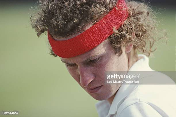 American tennis player John McEnroe pictured in action during competition to progress to win the final of the 1981 Queen's Club Championships tennis...