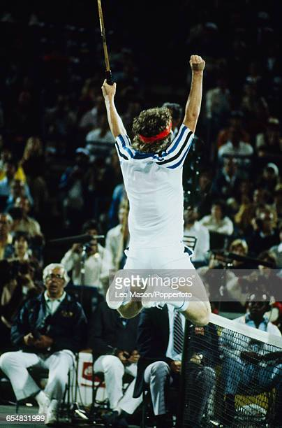 American tennis player John McEnroe pictured leaping in the air in celebration after winning the final of the 1979 US Open Men's Singles tennis...