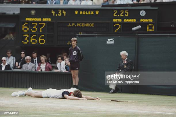 American tennis player John McEnroe pictured lying face down on the court during the final of the Men's Singles tournament before losing to Jimmy...