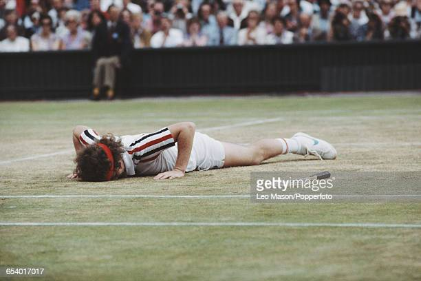 American tennis player John McEnroe pictured lying on the court durng progress to reach the final of the Men's Singles tournament before losing to...