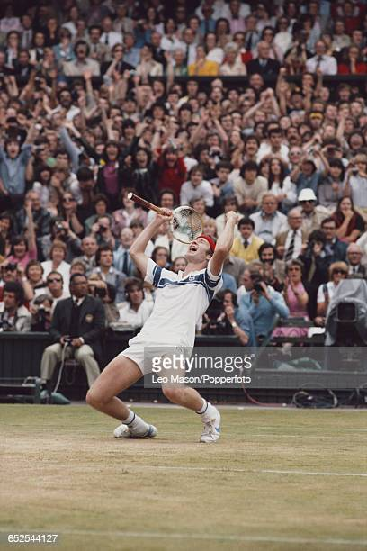 American tennis player John McEnroe pictured raising his hands in the air after winning the final of the Men's Singles tournament against Bjorn Borg...