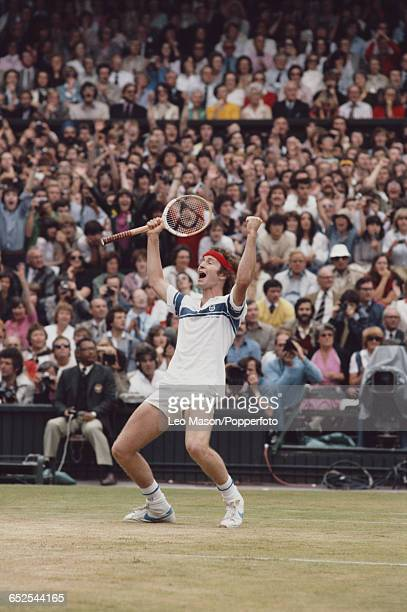 American tennis player John McEnroe pictured raising his hands in the air at match point in the final of the Men's Singles tournament against Bjorn...