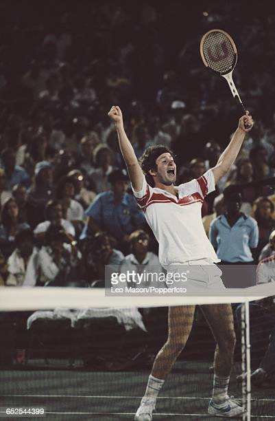 American tennis player John McEnroe pictured raising his hands in the air in celebration after winning the final of the 1980 US Open Men's Singles...