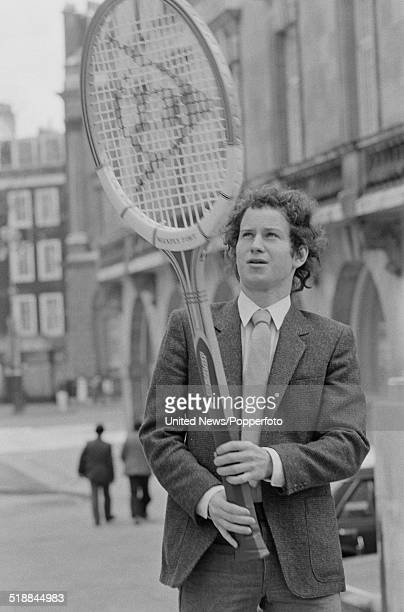 American tennis player John McEnroe posed holding an oversized Dunlop tennis racket in London on 20th March 1981