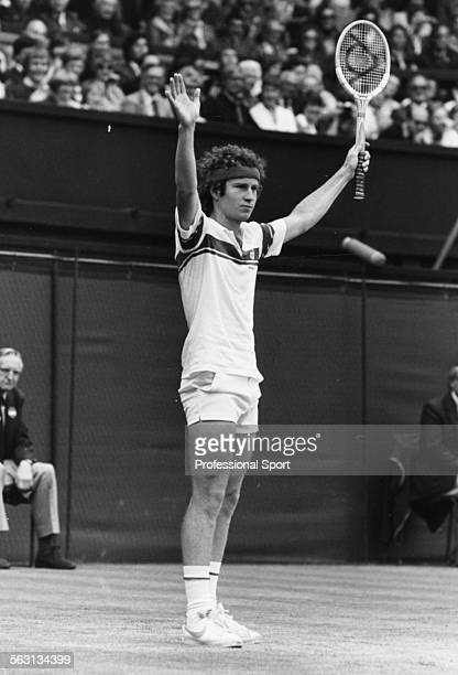 American tennis player John McEnroe raises his arms to the crowd after winning the Men's Singles final over Bjorn Borg on Centre Court at Wimbledon...