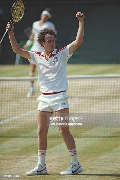 American tennis player John McEnroe pictured raising his hands in the air after winning the final of the Men's Singles tournament against Chris Lewis...