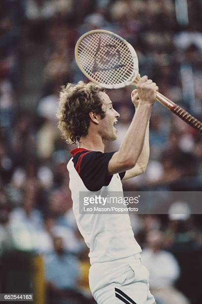 American tennis player John McEnroe pictured raising his hands in the air after winning the final of the 1981 US Open Men's Singles tennis tournament...