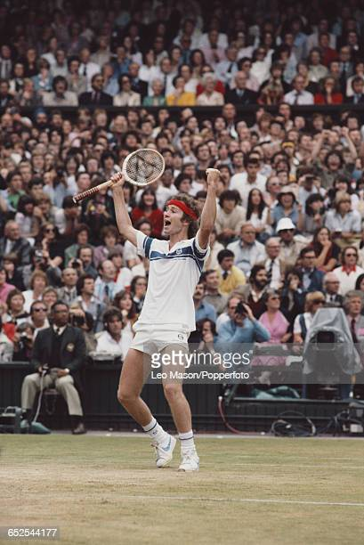American tennis player John McEnroe raises his hands in the air after winning the final of the Men's Singles tournament against Bjorn Borg of Sweden...