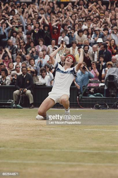 American tennis player John McEnroe pictured raising his hands in the air as he falls to his knees after winning the final of the Men's Singles...