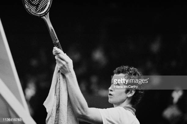 American tennis player John McEnroe talking to a referee during the final at Benson & Hedges Championships, Wembley Arena, London, UK, 16th November...